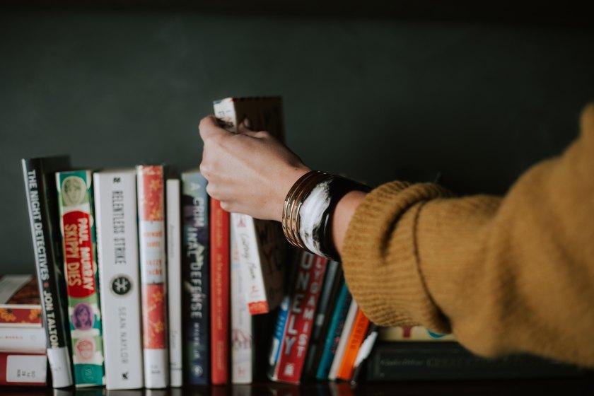 Girl putting books on a shelf